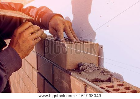 Bricklaying construction work manual labor. The construction of the house