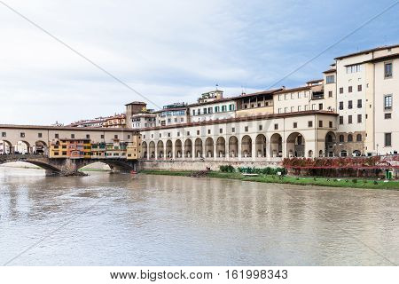 travel to Italy - vasari corridor and ponte vecchio over Arno River in Florence city poster