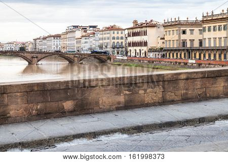 Bridges And Quay In Florence City In Autumn