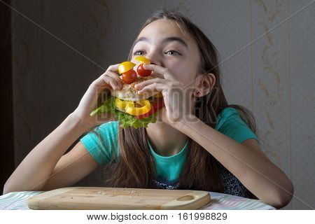11 Year Old Girl With Pleasure Eats A Hamburger
