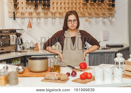 Portrait of ypung beautiful housewife wearing apron