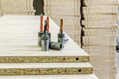 Details for the manufacture of furniture chipboard drilling in stacks poster