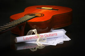 Acoustic Guitar With Music Sheet