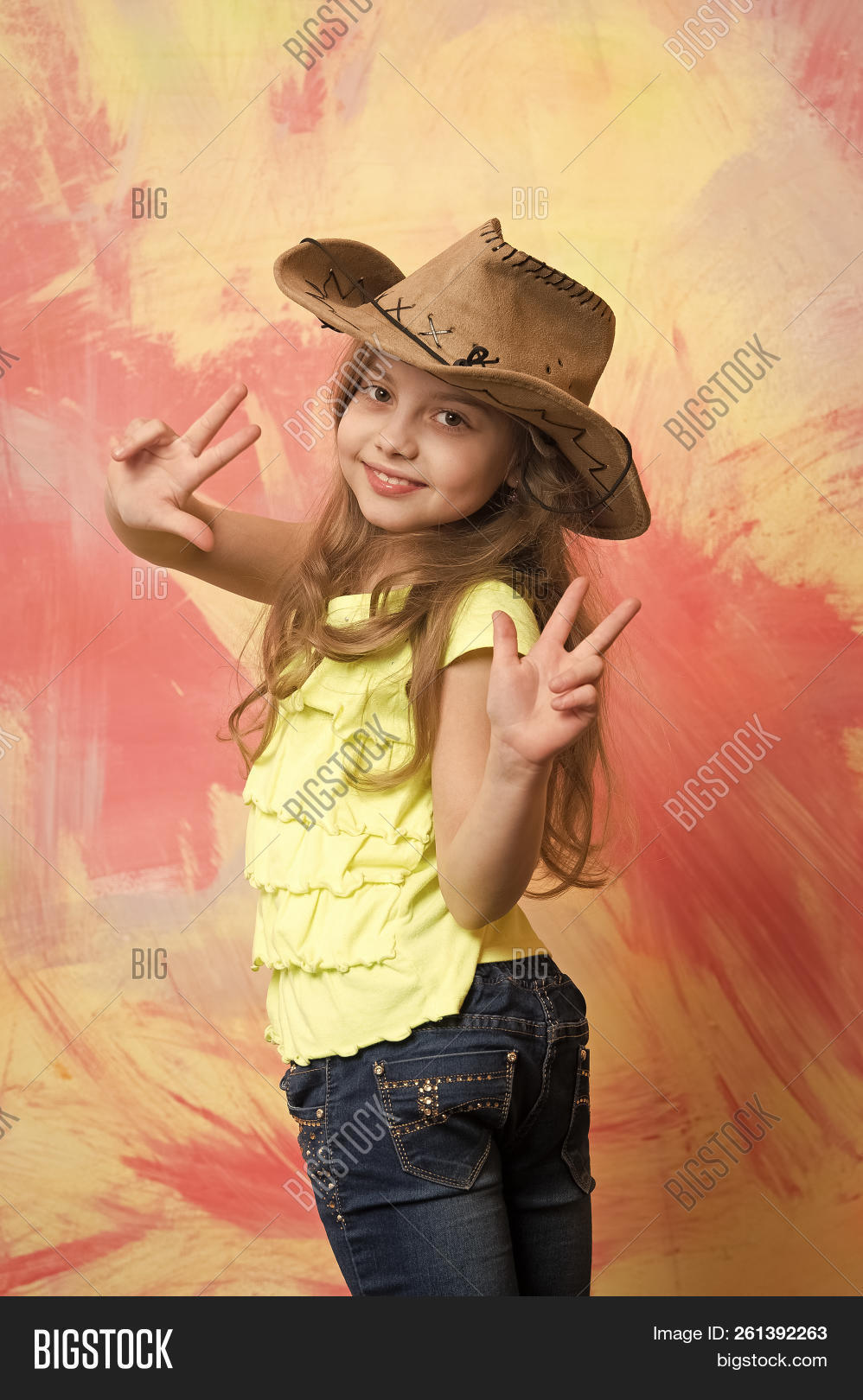 f544fad821d5c Cowgirl. Happy Child Or Little Girl In Cowboy Hat With Smiling Cute Face  And Raised