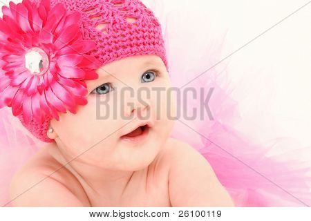 Beautiful 4 month old american baby girl in flower hat and tutu over white background.