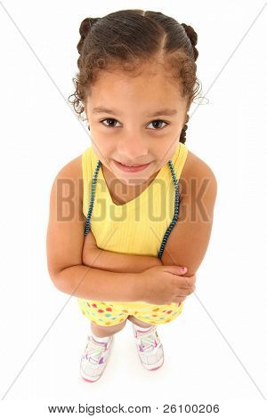 Adorable 3 year old hispanic african american girl standing over white background top view.