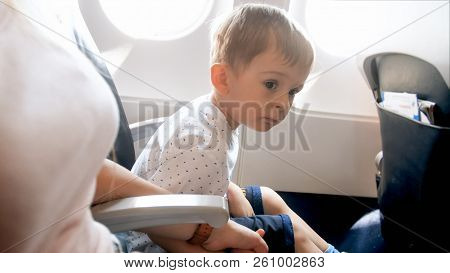 Portrait Of Little Toddler Boy Feeling Nervous Before First Flight In Airplane
