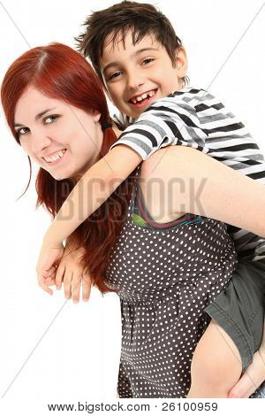 Adorable 8 year old boy getting piggy back ride from babysitter over white background.