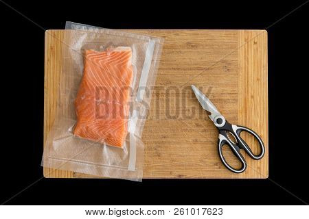 Fillet Of Fresh Atlantic Salmon Packaged Fro Freezing In A Vacuum Pack Of Clear Plastic Lying On A W
