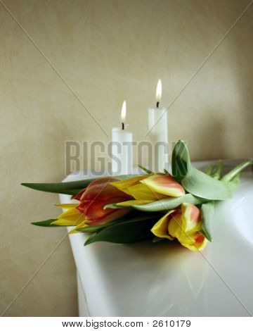 Beautiful tulips in red and yellow with candles behind for wedding or funeral poster