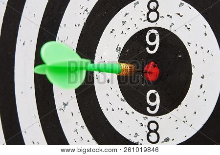 Green Dart Hits The Center Zone Of Target