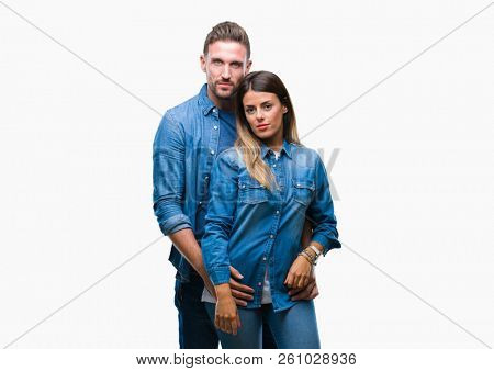 Young couple in love over isolated background with serious expression on face. Simple and natural looking at the camera.