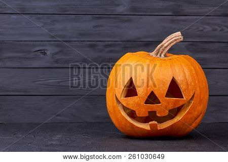 Halloween Pumpkin With Happy Expression. Halloween Pumpkin Head With Smile On Black Background, Copy