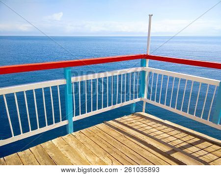 Summer Day On The Wooden Terrace Dock Or Pier.  Perspective Of Wooden Pier Or Dock Seashore With Cle