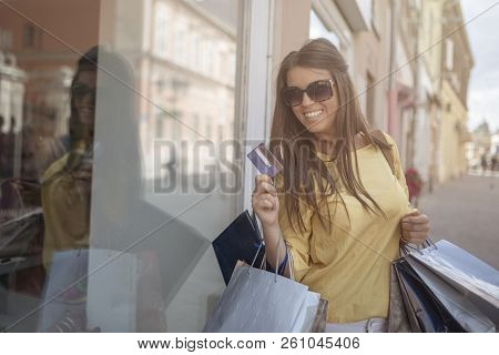 Woman With Credit Card By Shop Window. Girl Enjoying Shopping On Sunny Day In Town. Shopping Fun. Wo