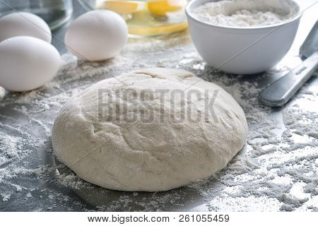 Freshly Made Pizza Bread Dough On A Stainless Steel Counter Top.