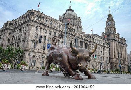 Shanghai - Jun 22 , 2018: Bronze Bull On The Bund In Shanghai, Iron Bull Statue Out Front Of Chinese