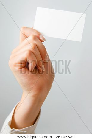 Blank business card in woman's hands - place your own text on it.