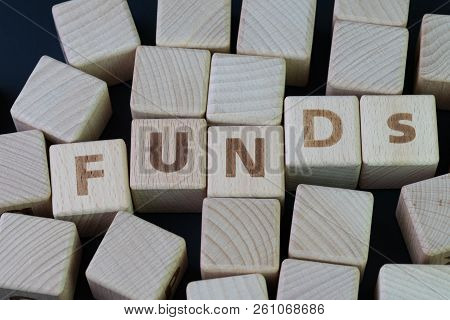 Mutual Funds, Investment Asset Selection By Performance Concept, Cube Wooden Block With Alphabet Com
