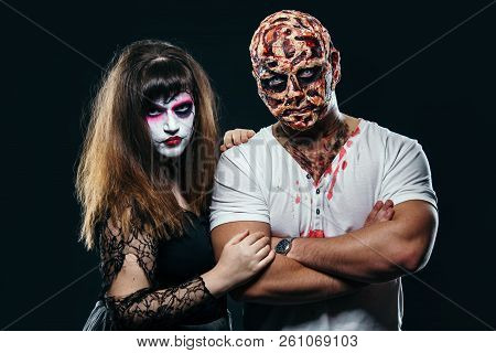 Scary Man With A Face Burn With A Witch On A Black Background, Zombie And A Dead Bride On A Hallowee