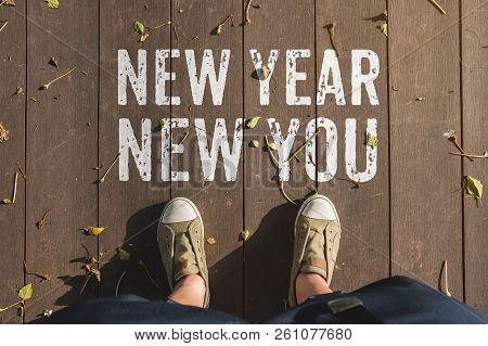 Aerail View Of New Year New You Word On Wooden Plank Floor With People Foot Wear Canvas Shoe Standin