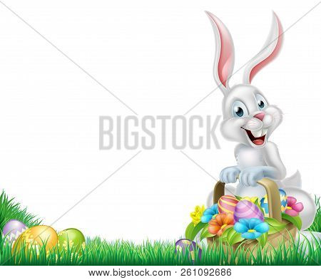 Cartoon Easter Scene. White Easter Bunny With A Basket Full Of Decorated Chocolate Easter Eggs In A