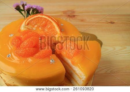 Mouthwatering Mandarin Orange Cake With One Piece Cut From The Whole Cake