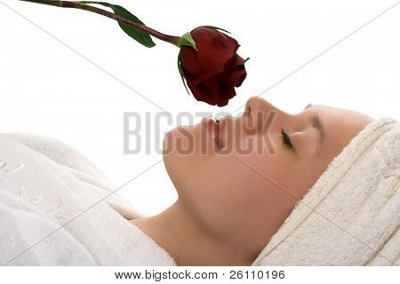 beauty girl in towel with rose  relaxing after shower on white background