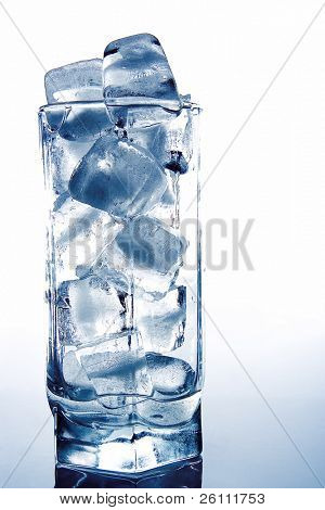 brick of ice in the glass on grey