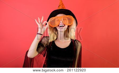 Halloween Witch In Hat Show Ok Sign. Happy Girl In Halloween Costume. Witch Magic. Halloween Costume