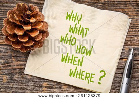 why, what, who, how, when, where brainstorming or decision making questions - handwriting on a napkin