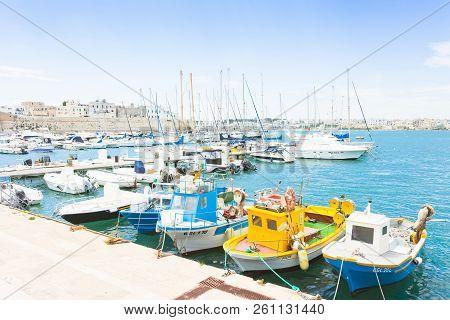 Otranto, Apulia, Italy - May 2017 - Several Fishing Boats At The Quay Of Otranto In Italy