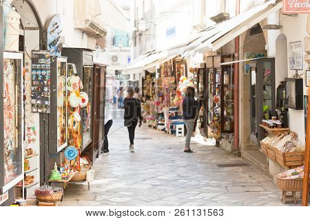 Otranto, Apulia, Italy - May 2017 - A Touristic Shopping Lane Within The Pedestrian Area Of Otranto