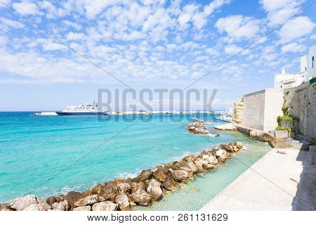 Otranto, Apulia, Italy - Sunbathing At The Quay Of Otranto In Italy