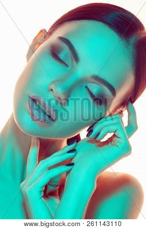 High Fashion Model Woman In Colorful Bright Lights Posing In Studio, Portrait Of Beautiful Sexy Girl