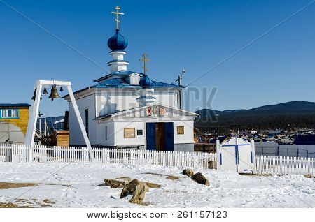 Khuzhir, Russia - March, 23, 2013: White Orthodox Church In The Olkhon Island In Winter Sunny Day.