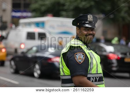 New York, Usa - Sep 26, 2018: Black Police Officer Performing His Duties On The Streets Of Manhattan