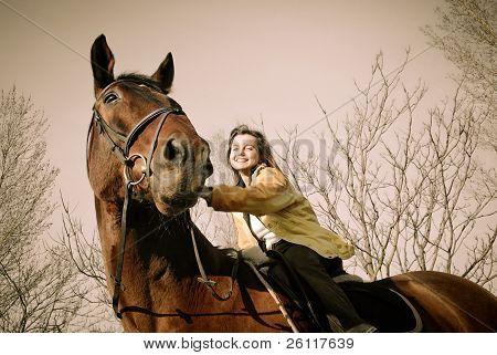 Woman Riding On Big Browm Horse