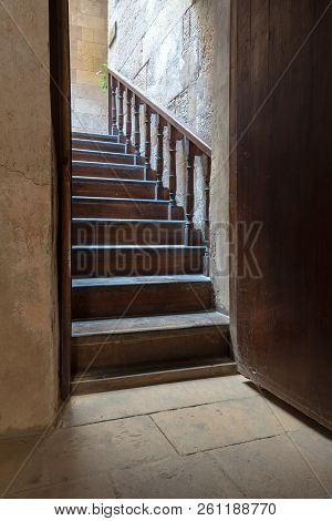 Open Wooden Door Revealing Wooden Old Staircase Going Up Located At The House Of Egyptian Architectu