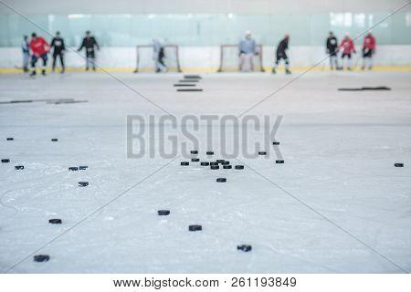 Ice Rink Hockey Training, Pucks And Players