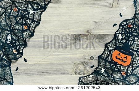 Halloween background. Spider web, cobweb lace and smiling jack decorations as the symbols of Halloween on the wooden background, Halloween background with free space for Halloween text