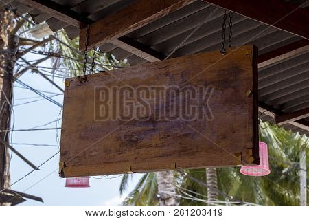 Blank Wooden Board Sign Hang Under Roof. Tropical Island Cafe Or Hotel Sign Mockup. Wooden Board Wit