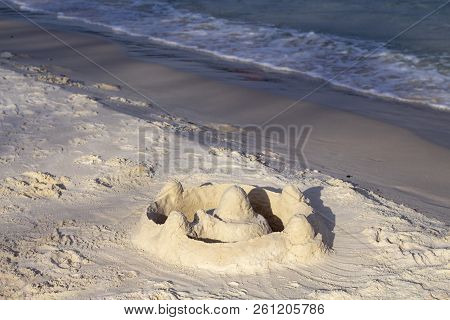 Sand Castle On Beach In Sunlight. Tropical Seaside Landscape With White Sand Beach. Beach Day Activi