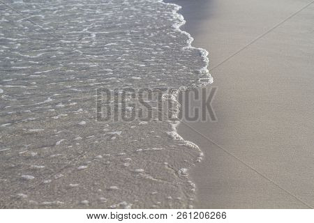 Sea Water Tide On White Sand Beach. Clear Sea Wave On Smooth Sand. Tropical Seaside Photo. Summer Va