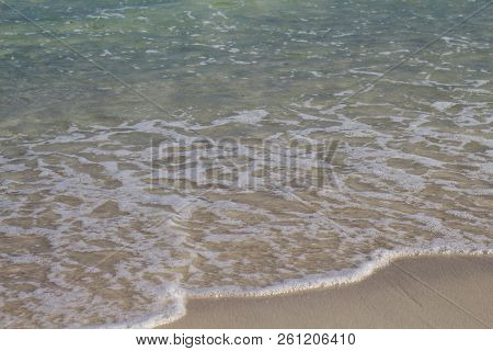 Sea Water Tide On White Sand Beach. Turquoise Sea Wave On Smooth Sand. Tropical Seaside Photo. Summe