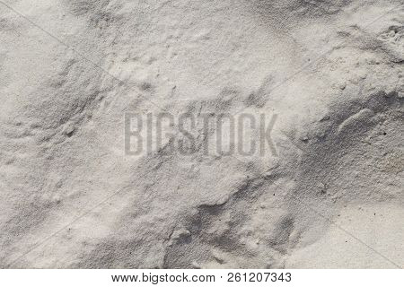 White Sand Beach Texture. Marine Coast Top View Photo. Natural Texture. Smooth Sand Surface With Win