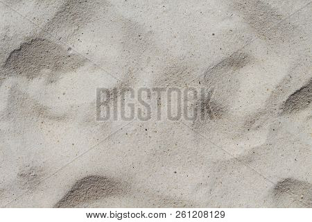 White Sand Beach Texture. Sea Coast Top View Photo. Natural Texture. Smooth Sand Surface With Step M