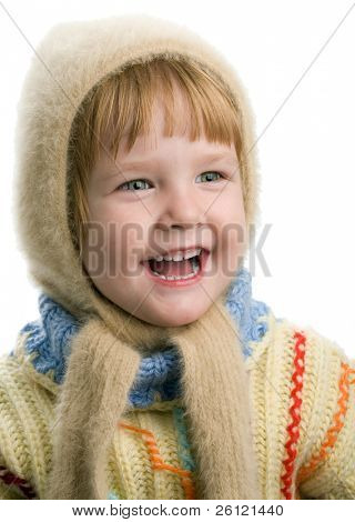 little girl in warm sweater and cap on white background
