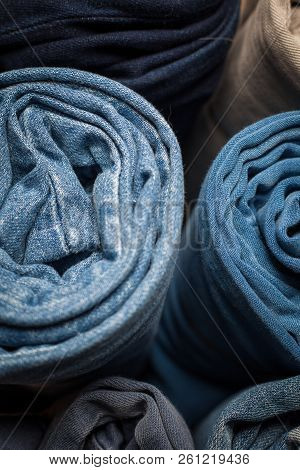 Closeup Photo Of Several Rolled Pairs Of Jeans