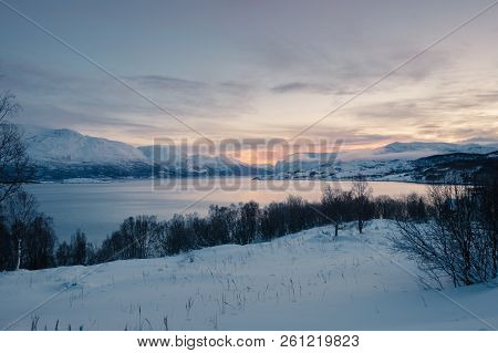 Landscape Of Norway In Winter At Blue Hour. Norwegian Coastline In Winter. Mountain Covered With Sno